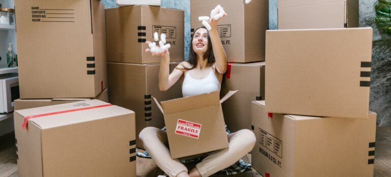 Girl surrounded by boxes