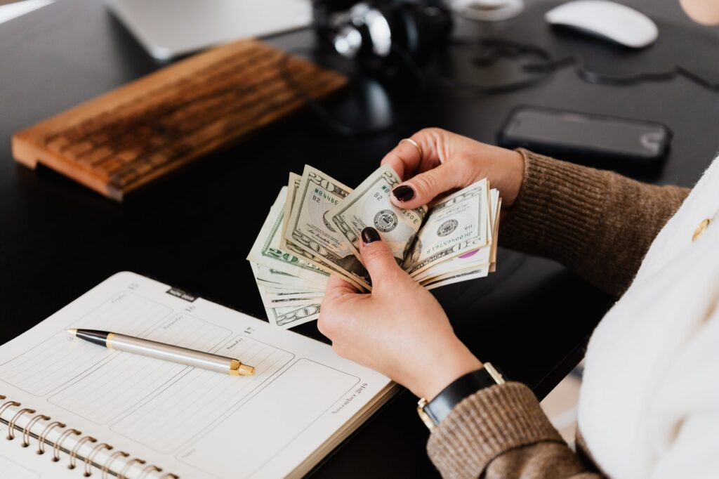 A woman counting money, and making plans