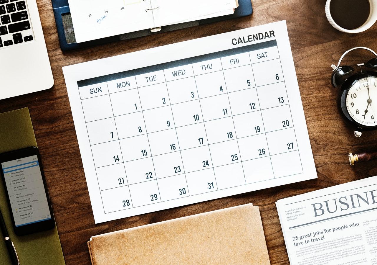 A calendar on a wooden table