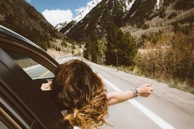a woman enjoying car ride