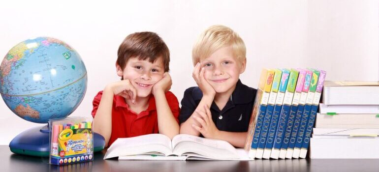Two boys in the classroom after moving from Glendale to Chandler