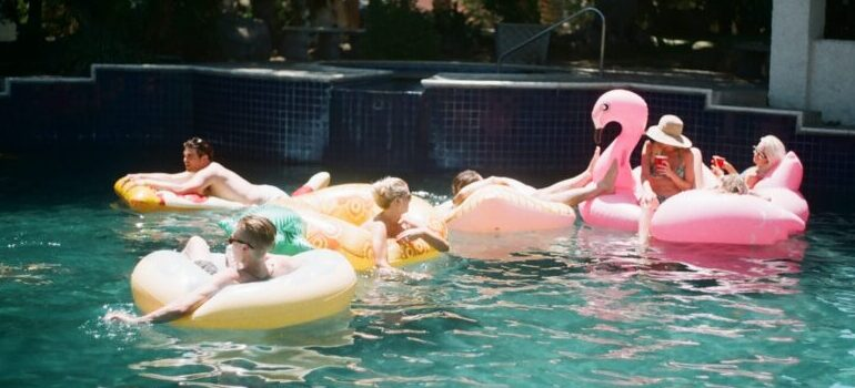 people in a pool, enjoying themselves