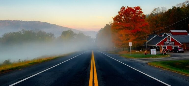 Moving from Texas to Massachusetts - a country road clouded by fog