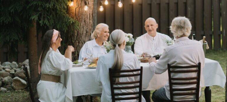 A group of elderly people having dinner.