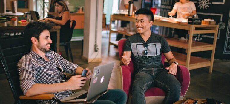 Young entrepreneurs having fun in a coffe shop.