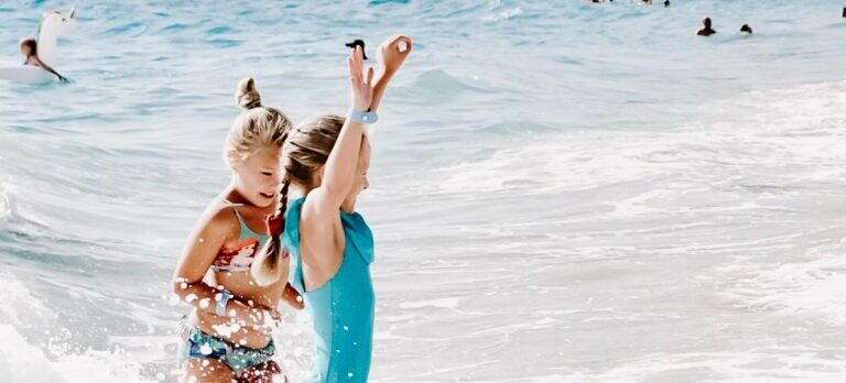 Two young girls having fun in the ocean.