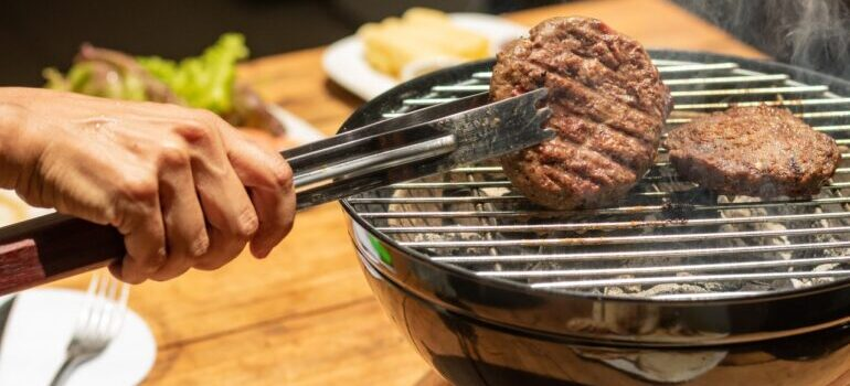A person grilling meat.