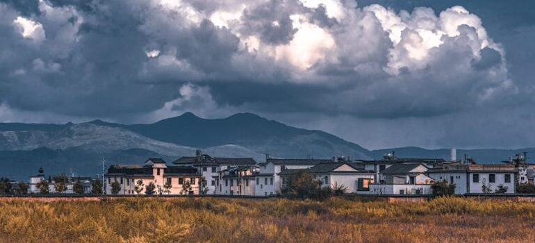 thunderclouds over a village