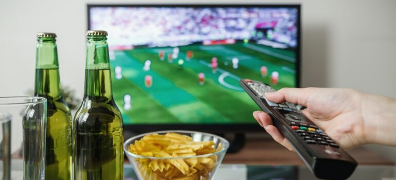 A person watching sports on TV.
