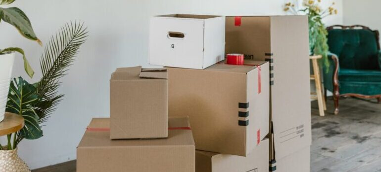 a stack of cardboard moving boxes and assorted packing materials