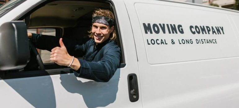 """professional mover giving a """"thumbs up"""""""